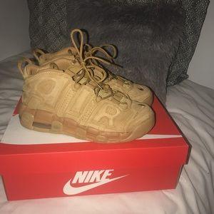 Barley worn Nike Uptempos
